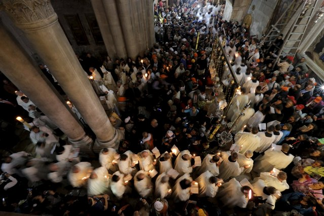 Members of the Catholic clergy hold candles during Easter procession in the Church of the Holy Sepulchre in Jerusalem's Old City April 5, 2015. (Photo by Ammar Awad/Reuters)