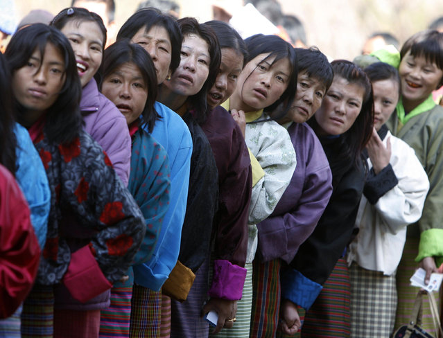 Voters stand outside a polling station to cast their ballot in Thimpu, Bhutan, March 2008. (Photo by Desmond Boylan/Reuters)