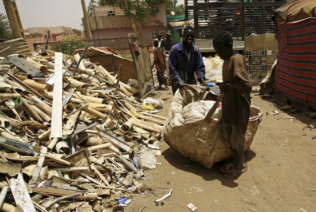 People bring a sack of plastic materials to a recycling station in Khartoum North April 16, 2015. (Photo by Mohamed Nureldin Abdallah/Reuters)