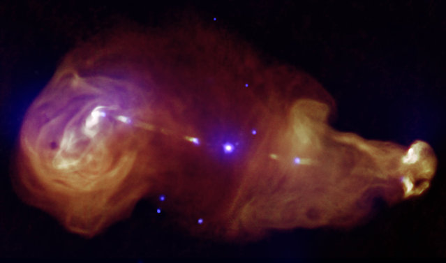 Giant plumes of radiation from galaxy 3C353, a wide, double-lobed active galaxy that is very luminous at radio wavelengths, where the galaxy is the tiny point in the center. Jets generated by supermassive black holes at the centers of galaxies can transport huge amounts of energy across great distances. (Photo by Reuters/NASA)
