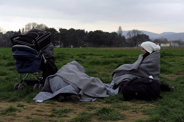 Refugees rest at a field next to a makeshift camp set by stranded refugees and migrants waiting to cross the Greek-Macedonian border, near the Greek village of Idomeni, February 29, 2016. (Photo by Alexandros Avramidis/Reuters)