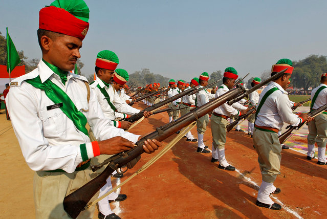 Policemen load their rifles as they take part in the India's Republic Day parade in Allahabad, India January 26, 2017. (Photo by Jitendra Prakash/Reuters)