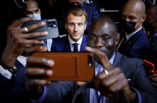French President Emmanuel Macron (C) poses for a selfie after a basket-ball game during an Africa-France 2021 Summit in Montpellier, southern France, on October 8, 2021. (Photo by Ludovic Marin/AFP Photo)