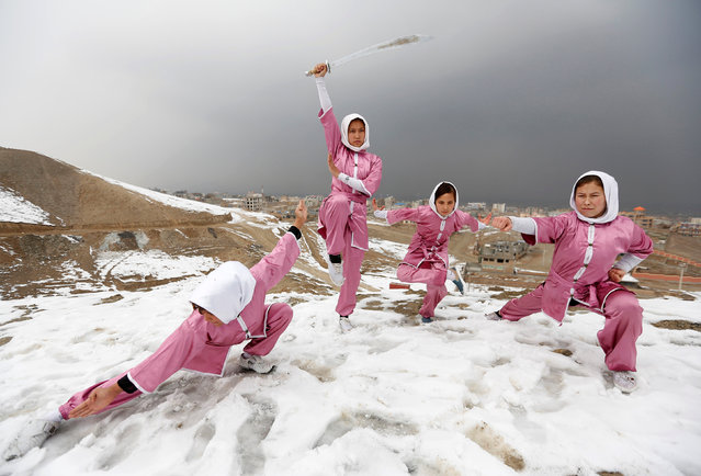 Hanifa Doosti (C), 17,  and other students of the Shaolin Wushu club show their Wushu skills to other students on a hilltop in Kabul, Afghanistan January 29, 2017. (Photo by Mohammad Ismail/Reuters)