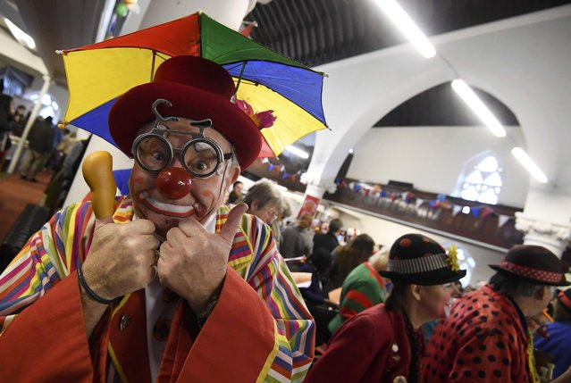 Clowns and entertainers gather to attend an annual service of remembrance in honour of British clown Joseph Grimaldi at All Saints Church in Haggerston in London, Britain, February 5, 2017. (Photo by Toby Melville/Reuters)