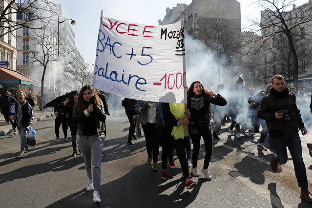 High school students carry a banner from the Lycee Mozart as French high school and university students take part in a demonstration against the labour reform bill proposal in Paris, France, March 17, 2016 as part of a nationwide labor reform protest. (Photo by Benoit Tessier/Reuters)