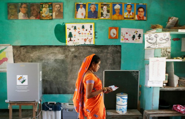 A woman leaves after casting her vote at a polling station during the first phase of general election in Majuli, a large river island in the Brahmaputra river, in the northeastern Indian state of Assam, India on April 11, 2019. (Photo by Adnan Abidi/Reuters)