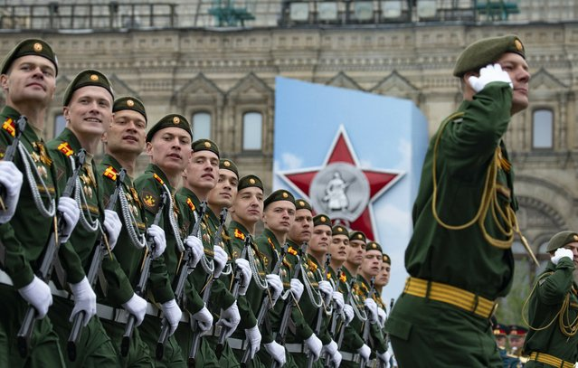 Russian troops march during the Victory Day military parade to celebrate 74 years since the victory in WWII in Red Square in Moscow, Russia, Thursday, May 9, 2019. Putin has told the annual military Victory Day parade in Red Square that the country will continue to strengthen its armed forces. (Photo by Alexander Zemlianichenko/AP Photo)