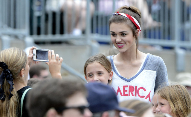 Duck Dynasty reality TV star Sadie Robertson poses for a picture during the AHSAA Class 3A championship game at Riverwalk Stadium in Montgomery, Ala., Friday, May 15, 2015. Her boyfriend, Blake Coward, is the Madison Academy catcher. Madison Academy defeated Geneva 14-2. (Photo by Mark Almond/AL.com via AP Photo)