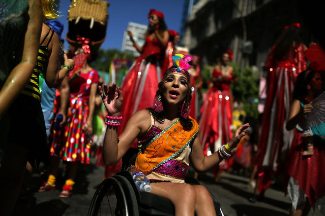 A reveller in a weelchair takes part in the annual block party Cordao do Boitata during pre-carnival festivities in Rio Janeiro, Brazil February 19, 2017. (Photo by Pilar Olivares/Reuters)