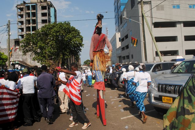 A man on stilts walks through the streets during an official celebration of the country being declared Ebola-free in Monrovia, Liberia, May 11, 2015. Liberia was declared free from Ebola by the government and the World Health Organisation (WHO) on Saturday after 42 days without a new case of the virus, which killed more than 4,700 people there during a year-long epidemic. (Photo by James Giahyue/Reuters)