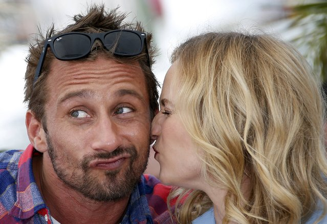"Cast member Diane Kruger (R) kisses actor Matthias Schoenaerts as they pose during a photocall for the film ""Maryland"" (Disorder) in competition for the category ""Un Certain Regard"" at the 68th Cannes Film Festival in Cannes, southern France, May 16, 2015. (Photo by Eric Gaillard/Reuters)"