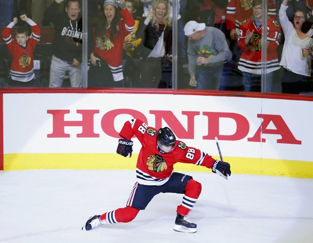 Chicago Blackhawks right wing Patrick Kane (88) celebrates his goal against the Boston Bruins during the first period of an NHL hockey game Sunday, April 3, 2016, in Chicago. (Photo by Jeff Haynes/AP Photo)