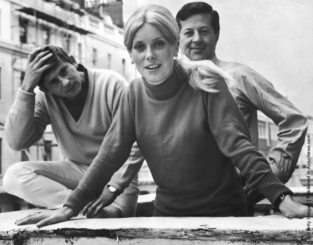 French actress Catherine Deneuve in London with Polish director Roman Polanski (left) and producer Eugene Gutowski, 17th August 1964. Deneuve is due to start shooting Polanski's film 'Repulsion' in a week's time