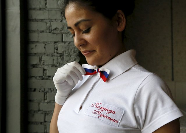 "A waitress straightens a bow tie in the colours of the Russian national flag at the ""President Cafe"" in Krasnoyarsk, Siberia, Russia, April 7, 2016. (Photo by Ilya Naymushin/Reuters)"