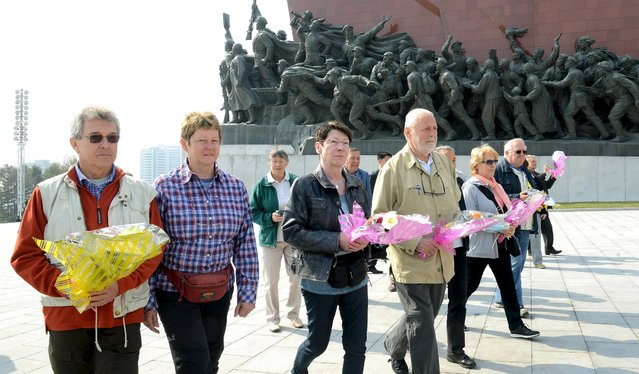 People visit the statues of North Korean founder Kim Il Sung and his son, former leader Kim Jong Il, on the anniversary of the birth of Kim Il Sung, in this undated photo released by North Korea's Korean Central News Agency (KCNA) in Pyongyang April 15, 2016. (Photo by Reuters/KCNA)