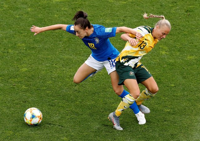 Brazil's Luana in action with Australia's Tameka Yallop during the Australia vs Brazil, Group C match at the FIFA Women's World Cup at Stade La Mosson Stadium on June 13th 2019 in Montpellier, France. (Photo by Eric Gaillard/Reuters)
