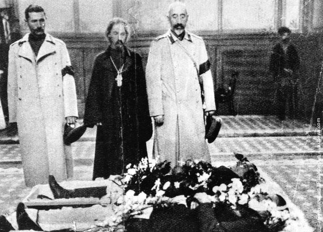 Church and armed forces officials pay their respects as bodies of the Potemkin's assassinated officers lie in state.  The mutiny aboard the battleship Potemkin sparked the uprising of 1905