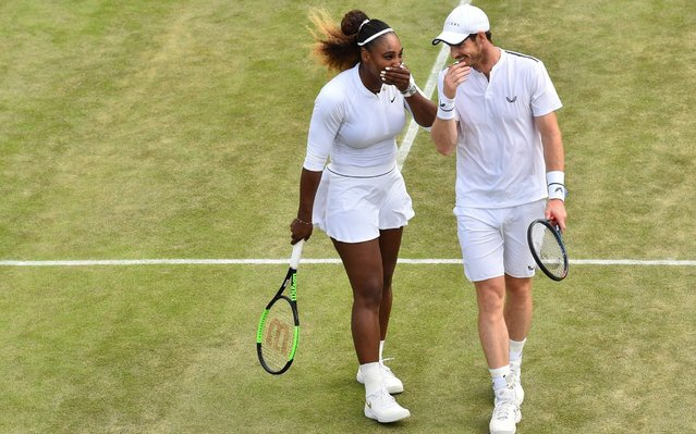 Britain's Andy Murray (R) and US player Serena Williams talk as they play Brazil's Bruno Soares and US players Nicole Melichar during their mixed doubles third round match on day nine of the 2019 Wimbledon Championships at The All England Lawn Tennis Club in Wimbledon, southwest London, on July 10, 2019. (Photo by Glyn Kirk/AFP Photo)