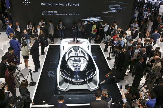 Visitors gather around the Faraday Future FFZERO1 electric concept car during the Auto China 2016 auto show in Beijing April 25, 2016. (Photo by Damir Sagolj/Reuters)