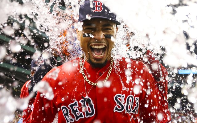 Mookie Betts #50 of the Boston Red Sox is showered in Gatorade after the Boston Red Sox defeated the New York Yankees 10-5 at Fenway Park on July 26, 2019 in Boston, Massachusetts. (Photo by Adam Glanzman/Getty Images)