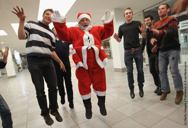 Stephan Stippi Antczack, alias Santa Claus, leads Santas-to-be in a theatrical exercise as part of his Santa workshop at the Studentenwerk Berlin