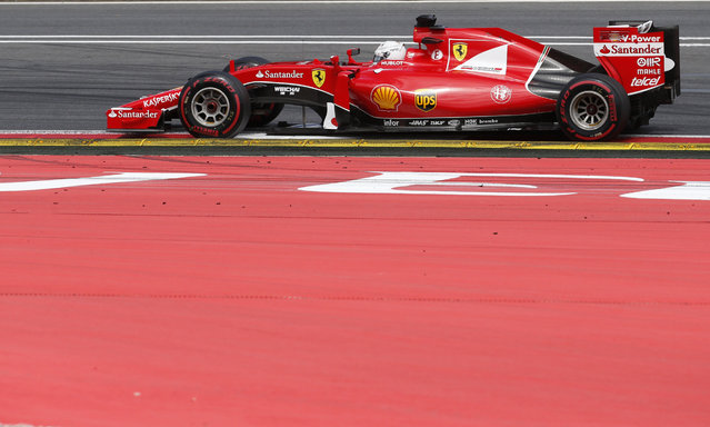 Ferrari driver Sebastian Vettel of Germany steers his car during the the Formula One Grand Prix race, at the Red Bull Ring in Spielberg, southern Austria, Sunday, June 21, 2015. (AP Photo/Darko Bandic)