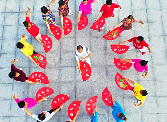 People practise tai chi in Taicang City, China on August 6, 2019. (Photo by Costfoto/Barcroft Media)