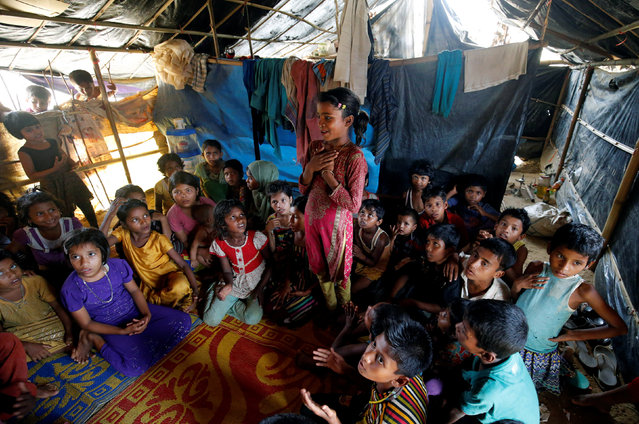A Rohingya girl gestures while reciting a poem at a makeshift school at Balukhali Makeshift Refugee Camp in Cox's Bazar, Bangladesh April 10, 2017. (Photo by Mohammad Ponir Hossain/Reuters)