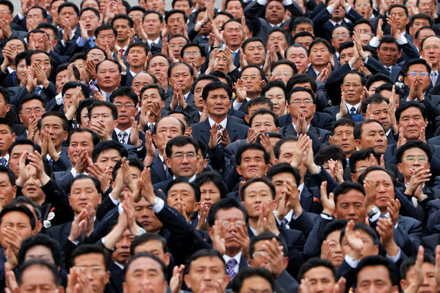 High party officials clap during a mass rally and parade in the capital's main ceremonial square, a day after the ruling party wrapped up its first congress in 36 years by elevating him to party chairman, in Pyongyang, North Korea May 10, 2016. (Photo by Damir Sagolj/Reuters)
