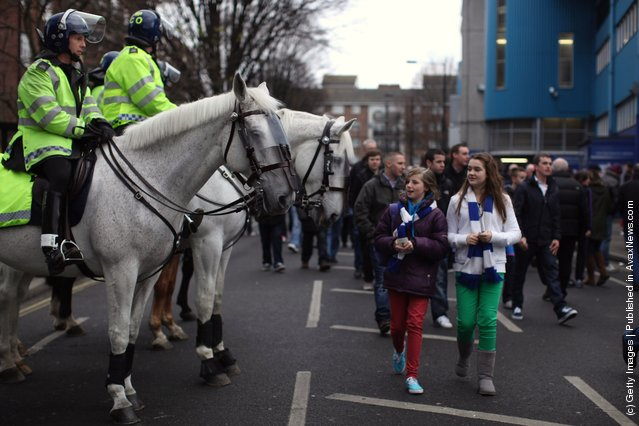 Fans makes their way into the Loftus Road stadium for the FA Cup Fourth Round between Queens Park Rangers and Chelsea