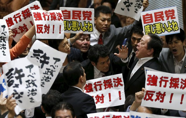 Yasukazu Hamada (2nd R), chairman of the Upper House Special Committee on Security, shouts as he is surrounded by opposition lawmakers during a vote on the security-related legislation at the parliament in Tokyo July 15, 2015. Legislation to implement a dramatic change in Japanese defence policy that could allow troops to fight abroad for the first time since World War Two was approved by a lower house panel on Wednesday, despite opposition from a majority of ordinary voters. (Photo by Toru Hanai/Reuters)