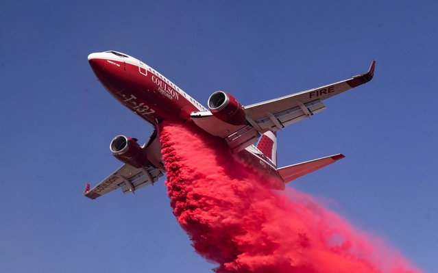 A plane drops fire retardant as firefighters contain the Easy Fire spreading near Simi Valley, North of Los Angeles, California, USA, 30 October 2019. (Photo by Etienne Laurent/EPA/EFE/Rex Features/Shutterstock)