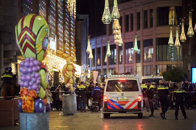 Dutch police block a shopping street after a stabbing incident in the center of The Hague, Netherlands, Friday, November 29, 2019. Dutch police say multiple people have been injured in a stabbing incident in The Hague's main shopping street. (Photo by Phil Nijhuis/AP Photo)