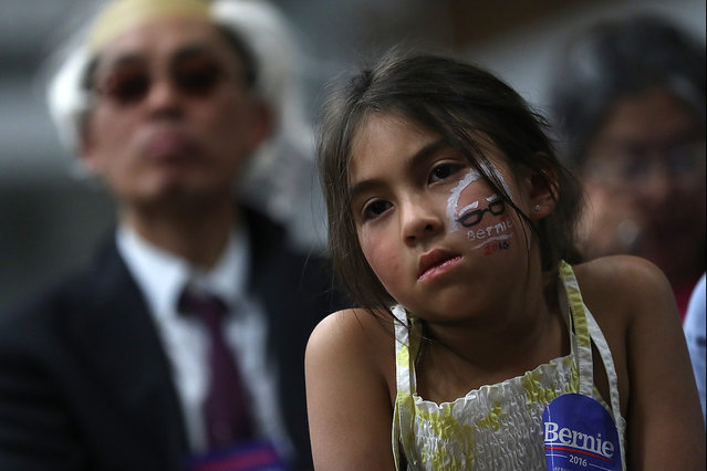 A supporter looks on as Democratic presidential candidate, U.S. Sen. Bernie Sanders (D-VT) speaks during a panel with Asian-Americans and Pacific Islanders at Cubberley Community Center on June 1, 2016 in Palo Alto, California. With less than a week to go before the California presidential primary, Sanders is campaigning in northern California. (Photo by Justin Sullivan/Getty Images)