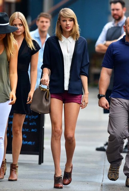 Taylor Swift steps out in a navy cardigan and magenta short shorts in New York City, on June 19, 2014. (Photo by PacificCoastNews)