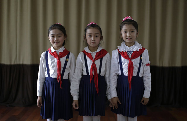 In this May 7, 2015, photo, Sin Ji Ye, 9, left, An Rye Jong, 10, center, and Kim Ye Yon, 8, right, pose for a portrait as they attend a singing class in Pyongyang, North Korea. (Photo by Wong Maye-E/AP Photo)