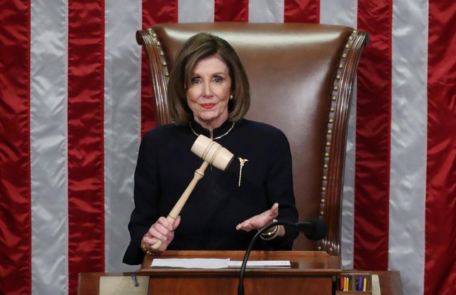 U.S. Speaker of the House Nancy Pelosi (D-CA) wields the Speaker's gavel as she presides over the final of two House of Representatives votes approving two counts of impeachment against U.S. President Donald Trump in the House Chamber of the U.S. Capitol in Washington, U.S., December 18, 2019. (Photo by Jonathan Ernst/Reuters)