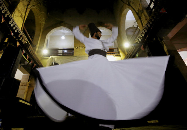 """The """"Mawlay Ensemble"""" band and whirling dervishes perform late night a traditional Mawlawi Sufi dance during the Muslim fasting month of Ramadan at Cultural Center EL-Raba in Old Cairo, Egypt June 16, 2016. (Photo by Amr Abdallah Dalsh/Reuters)"""
