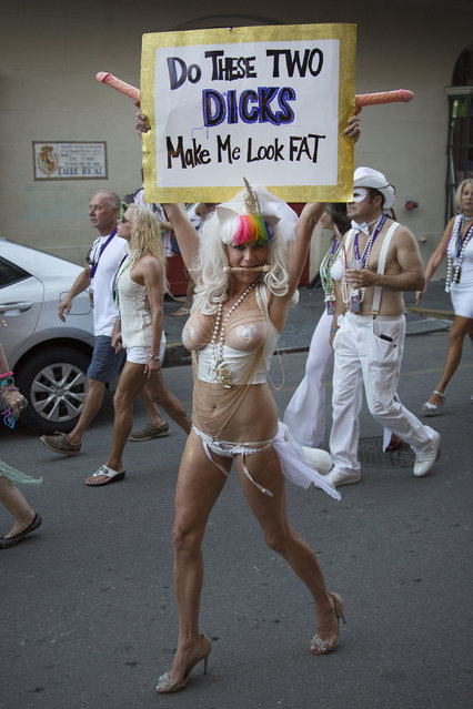 A woman with a provocative sign during the Sexual Freedom Parade, part of Naughty in N'awlins held in New Orleans, Louisiana, Wednesday July 5th, 2017. (Photo by Mathew Growcoot/News Dog Media)