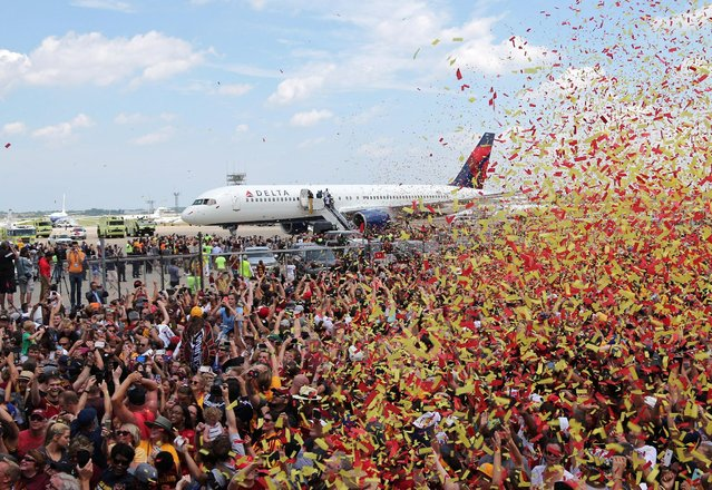 Cleveland Cavaliers fans celebrate as the team arrives home to a welcome party in Cleveland, Ohio, U.S., June 20, 2016. (Photo by Aaron Josefczyk/Reuters)