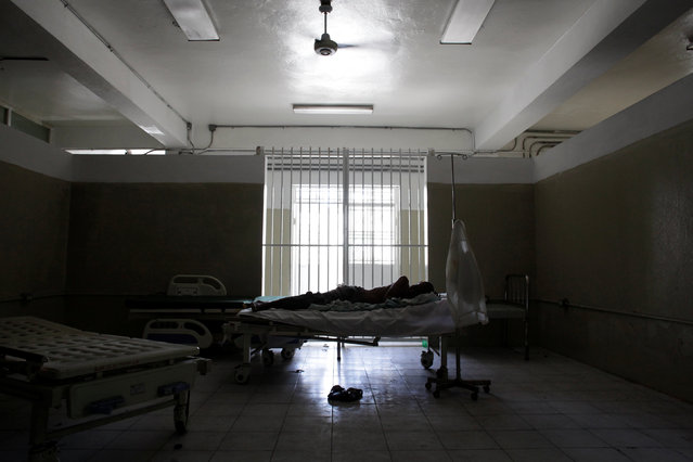A patient rests in a bed in the Hospital of the State University of Haiti, which is one of the centers affected by a three-month-long strike by health workers demanding a pay rise and resources, in Port-au-Prince, Haiti, June 20, 2016. (Photo by Andres Martinez Casares/Reuters)