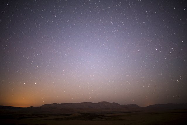 Meteor streaks across the sky in the early morning during the Perseid meteor shower in Ramon Carter near the town of Mitzpe Ramon, southern Israel, August 13, 2015. (Photo by Amir Cohen/Reuters)