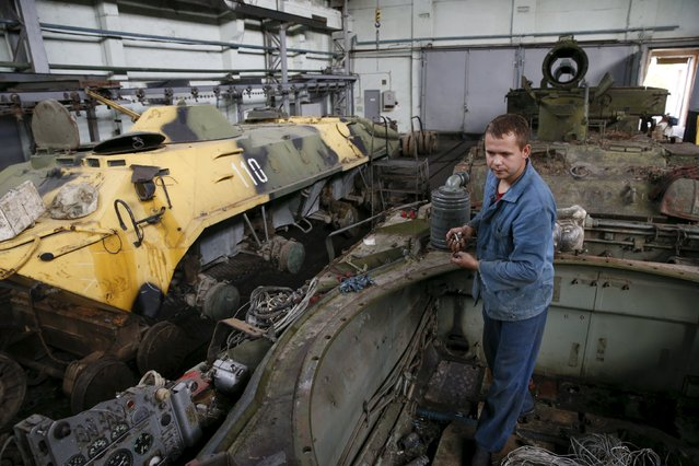 An employee repairs an armored personnel carrier at the Kiev armored plant, Ukraine, August 14, 2015. (Photo by Valentyn Ogirenko/Reuters)