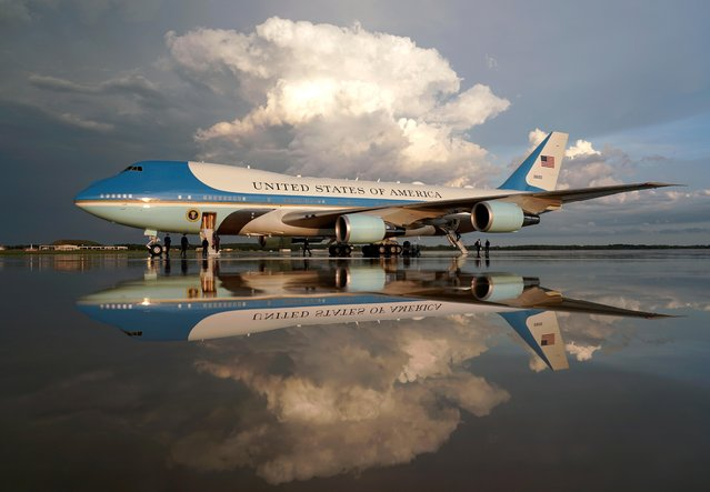 Air Force One is reflected on the rain-soaked tarmac following the return of U.S. President Donald Trump, at Joint Base Andrews in Maryland, U.S., August 21, 2019. (Photo by Kevin Lamarque/Reuters)