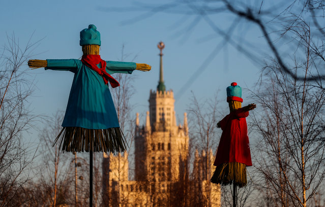 Effigies of Lady Maslenitsa are seen with a Stalin's era skyscraper in the background during celebrations of Maslenitsa, also known as Pancake Week, a pagan holiday marking the end of winter, in central Moscow, Russia on February 25, 2020. (Photo by Maxim Shemetov/Reuters)