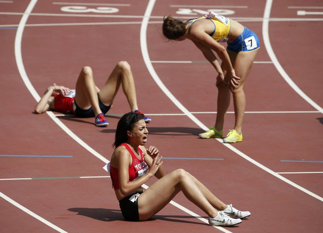 Athletes react after the women's 3,000 metres steeplechase heat during the 15th IAAF World Championships at the National Stadium in Beijing, China August 24, 2015. (Photo by David Gray/Reuters)