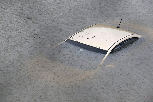 A submerged car is seen on Interstate 610 North on August 27, 2017 in Houston as the city battles with tropical storm Harvey and resulting floods. (Photo by Thomas B. Shea/AFP Photo)