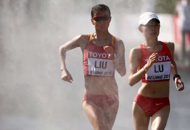 Liu Hong of China (L) and Lu Xiuzhi of China compete in the women's 20 km race walk final during the 15th IAAF World Championships at the National Stadium in Beijing, China August 28, 2015. (Photo by David Gray/Reuters)