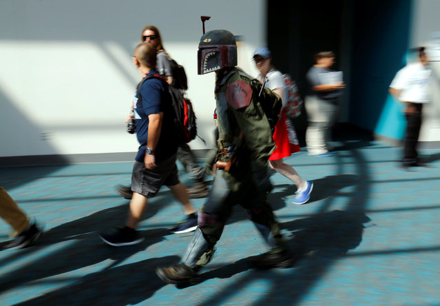 An attendee dressed as Boba Fett from Star Wars rushes his way at the pop culture event Comic-Con International in San Diego, California, United States July 22, 2016. (Photo by Mike Blake/Reuters)
